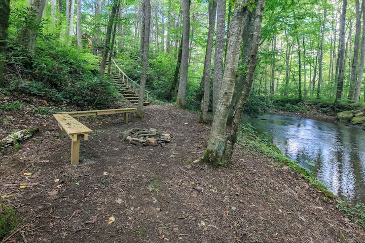 bench and firepit on the stream
