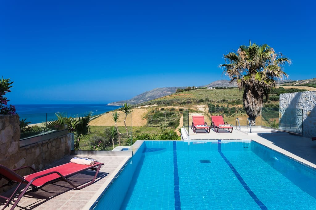 Relax on our Sun beds by the pool while enjoying sea views