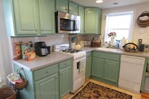 Eat-in kitchen w/ dishwasher and all cooking essentials.