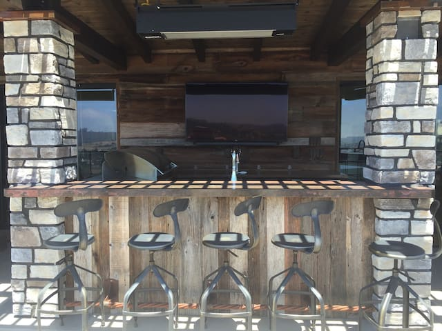 Watch your favorite team on the flat screen TV while sitting at the outdoor bar