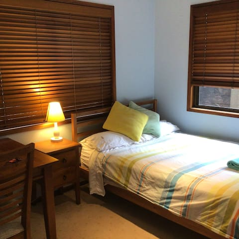 Your room has a double bed, desk and wardrobe