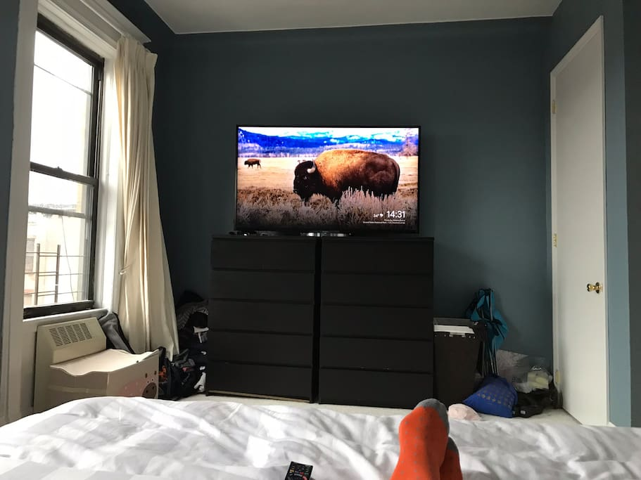 """View from the master bed. Google chrome for streaming, Netflix, HBO etc on the 64"""" Sony Bravia. Closet to the right"""
