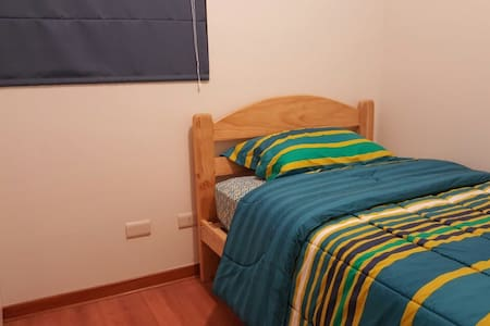 Quiet Private Bedroom close to Lima INTL Airport