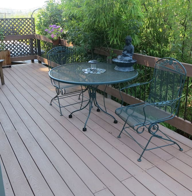 Deck attached to house, accessible from living room & kitchen