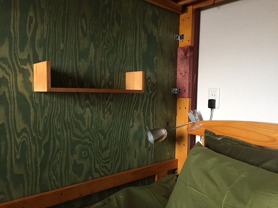 LED book light and shelf each bed.