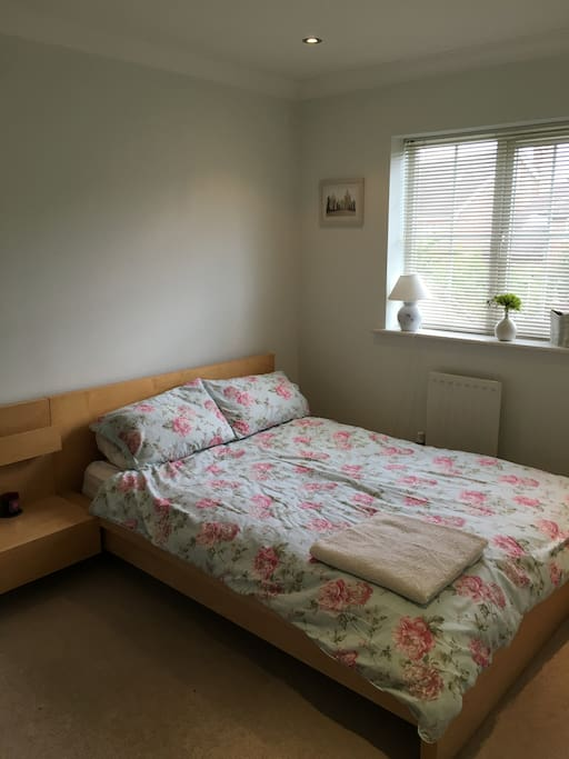 Bedroom 1 with double bed and wardrobe.