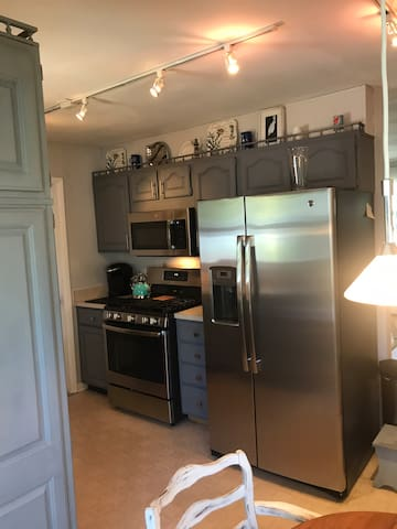 This cozy kitchen has Stainless steel refrigerator, dishwasher and a gas stove.  Plenty of cabinet space if you plan to stay a couple of days.