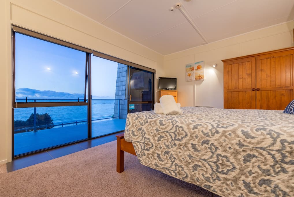 Main bedroom with King size bed. Overlooks Bay with private deck and retractable awning
