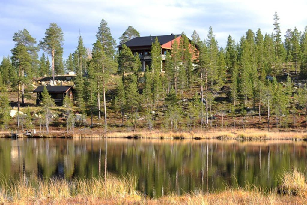 Marjarinne house and lakeside sauna seen from the other side of lake Martinjärvi
