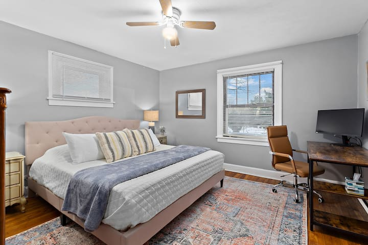 This bedroom features a king bed and television setup to access your preferred streaming service.