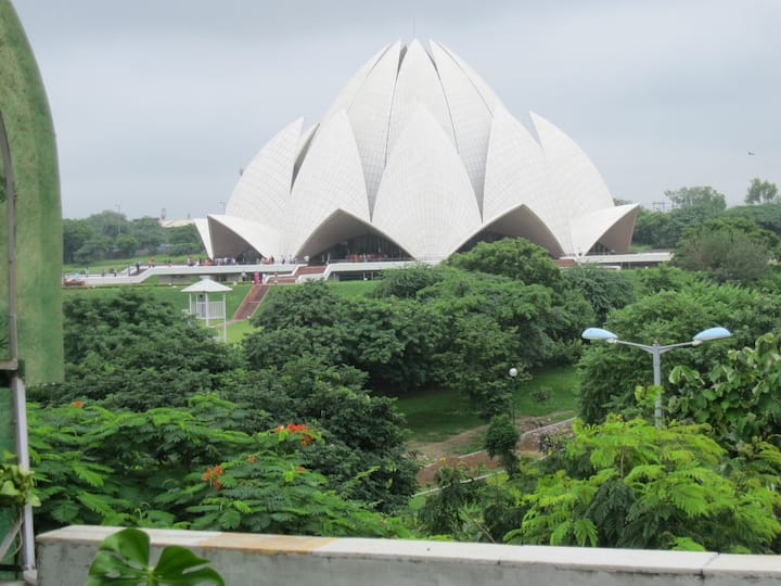 Sanitized Ind home acres of green and Lotus Temple