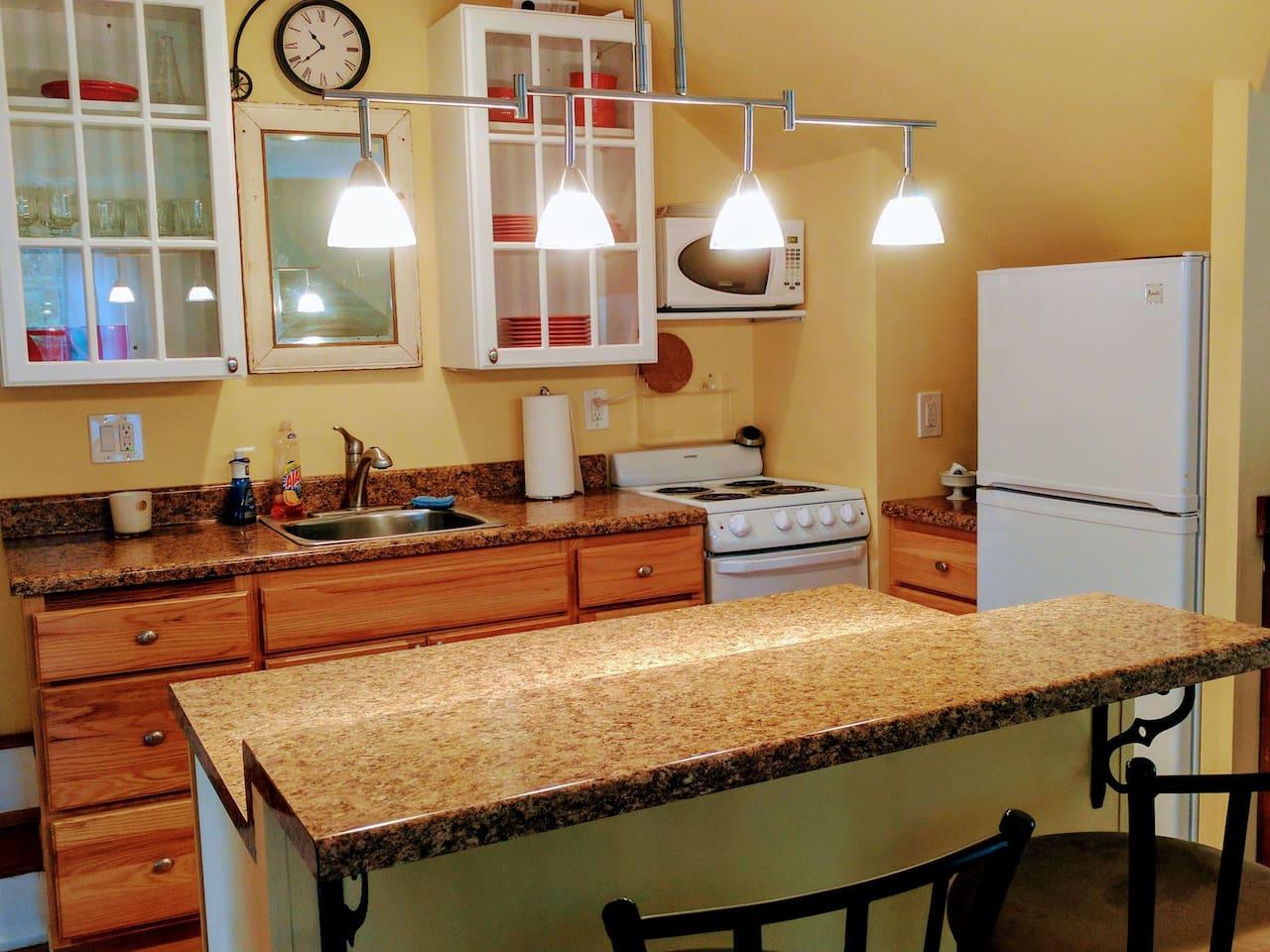 Kitchen, breakfast bar, refrigerator and stove