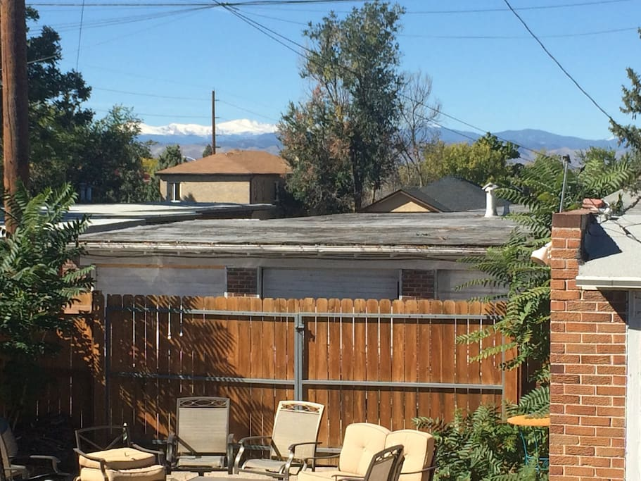 Backyard view of snowcapped mountains including Mount Evans