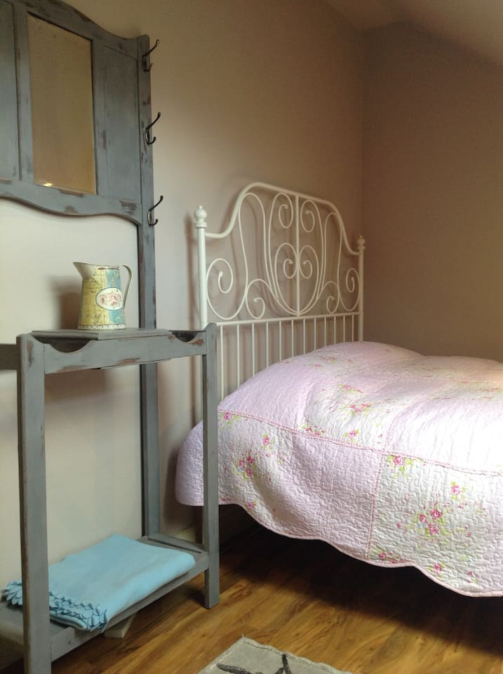 A double bedroom for one or two people, with a space for hanging clothes. A chair which converts to a single bed is also available for a child if required, but isn't suitable for babies or very young children, please ask for details if required.