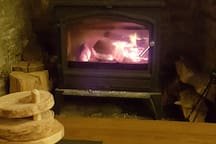 The log burning stove in the guest lounge
