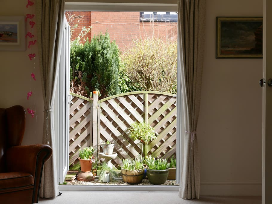 French windows from living room into small garden