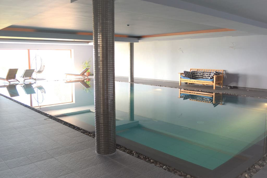 Imagine floating in your indoor pool looking out over amazing views of Dingle.