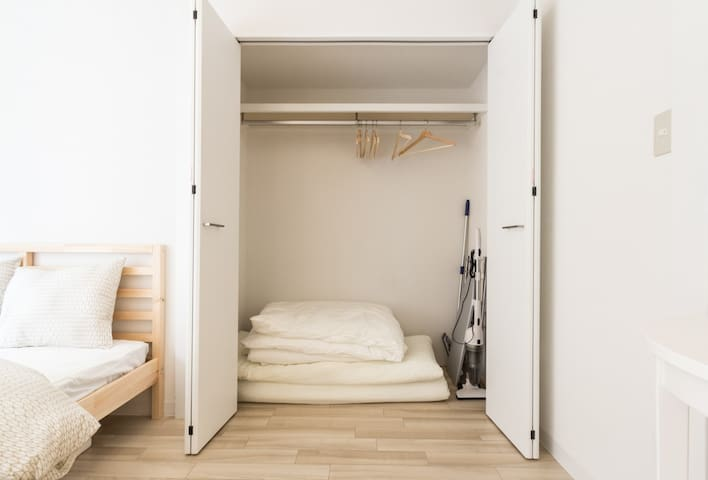 Spare double futon in the cupbaord and luggage space