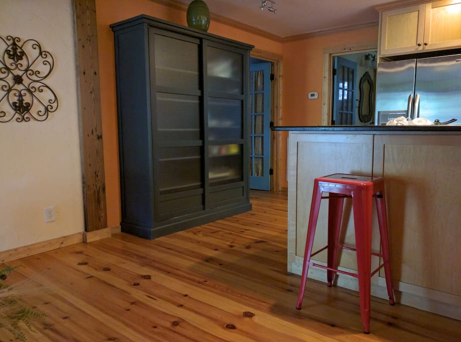 Open kitchen with granite countertops, a bar for dining or laptop workspace and more.