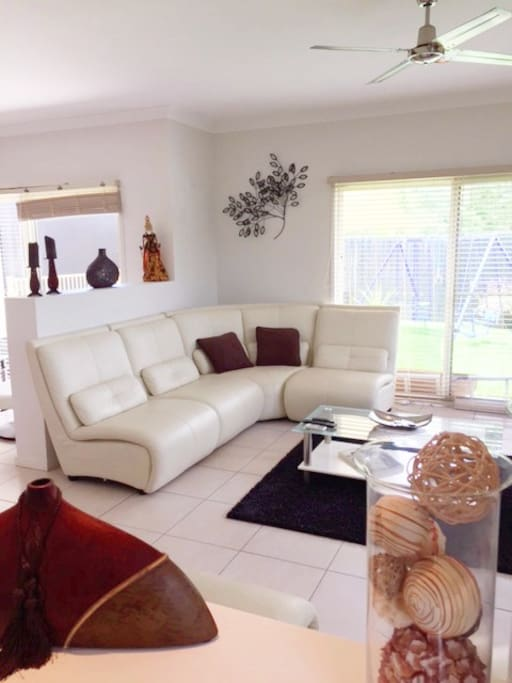 Formal Lounge with large screen TV and access to outdoors