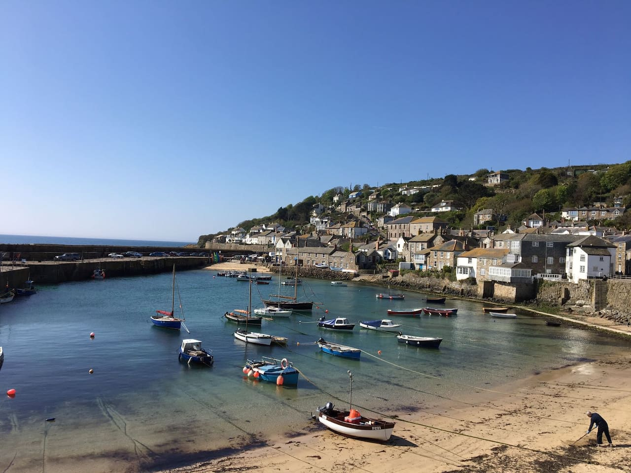 Mousehole harbour on a glorious spring morning