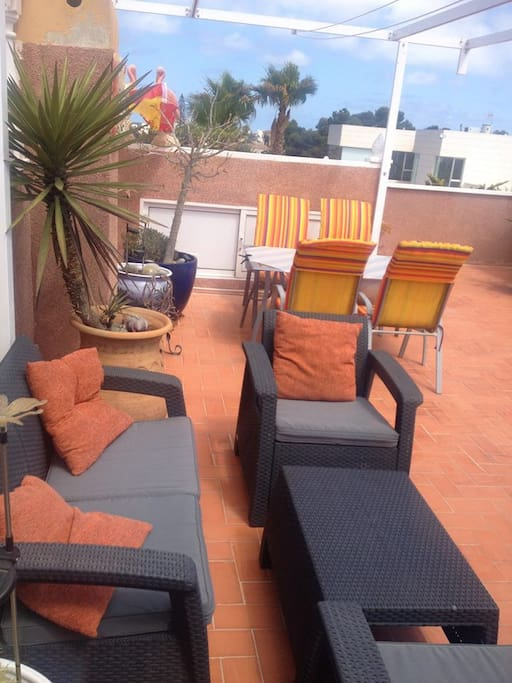 Solarium: sofas, table, chairs, beds- all for guests!