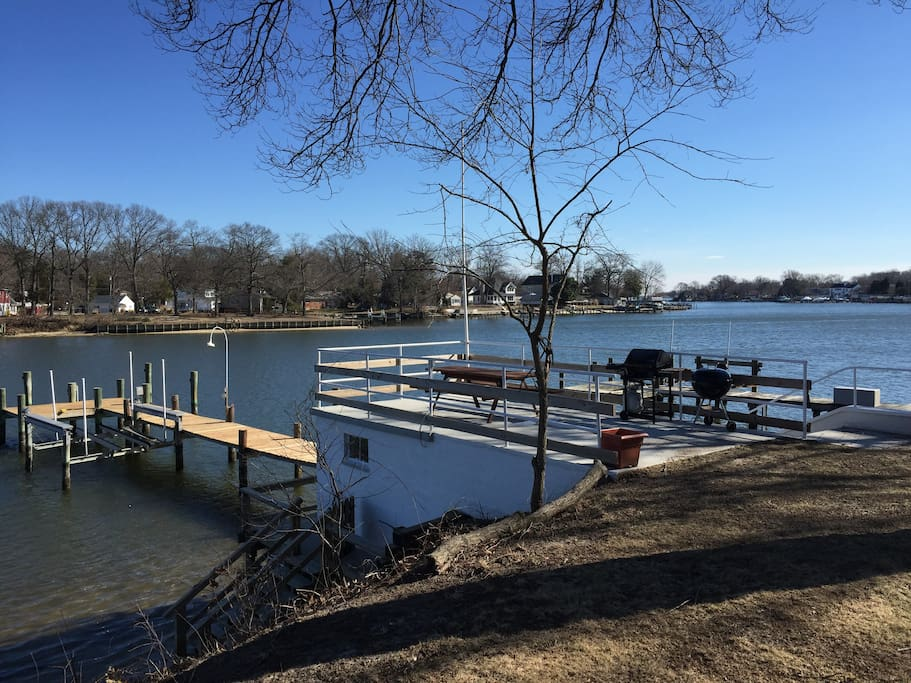 own private deep water dock and boat house with deck for BBQ's and eating crabs!