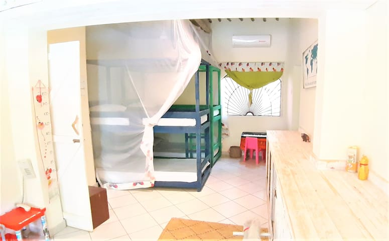 Kids room with toys and 2 bunk beds that sleeps 4 children comfortably.