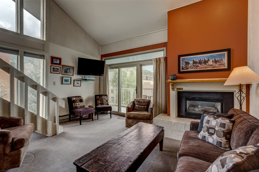 Curl up by the cozy gas fireplace in the living area.