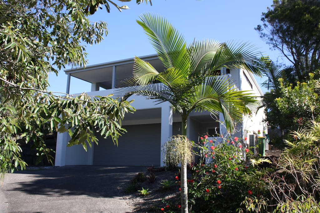 The house is tucked away in the high corner of a quiet cul-de-sac minutes away from the beach