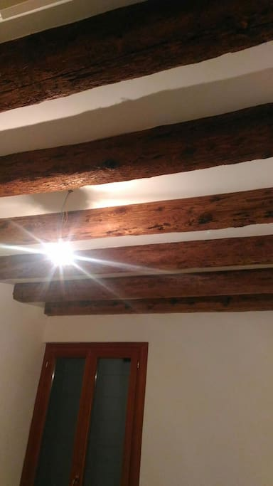 Beautiful exposed beams in the master bedroom.
