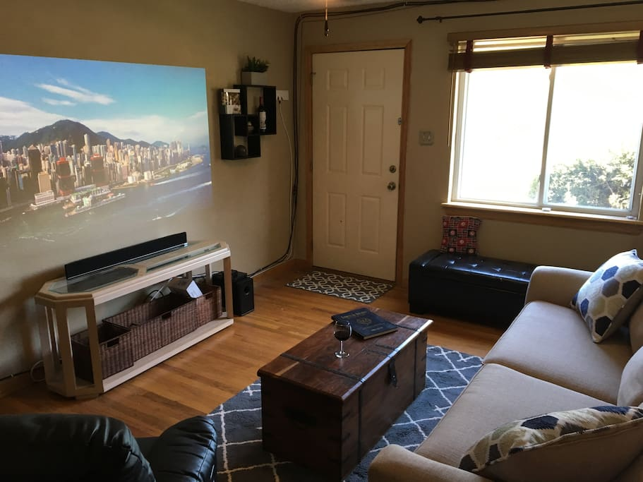 The living room featuring a large projector screen-perfect for sports or movies!