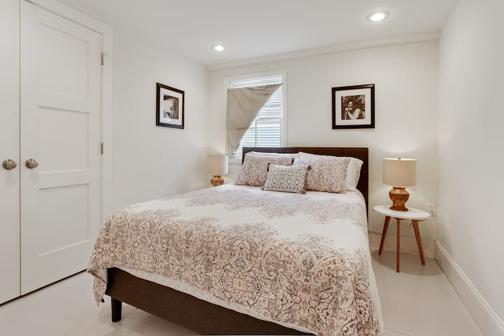 Queen bed in bedroom 2.  Spacious closet features room for hanging clothes and a 3 drawer dresser.