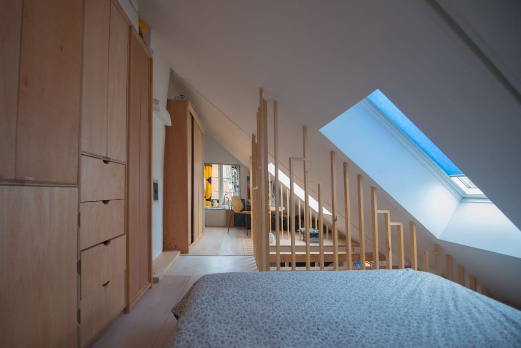 The upper level of the apartment with masses of light and comfortable king size bed
