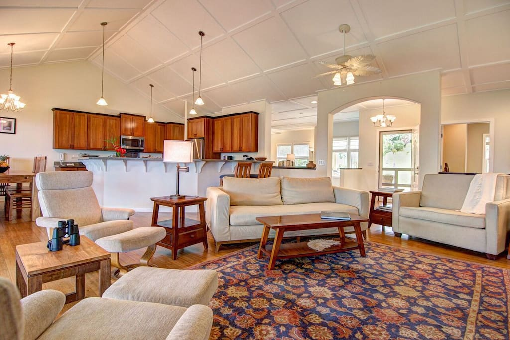 Gorgeous interior with open concept living room and vaulted ceilings