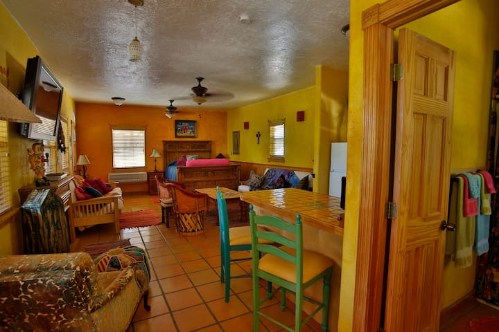 Queen bed, two futon beds, electric fireplace, full kitchen, sitting area and reading chair.