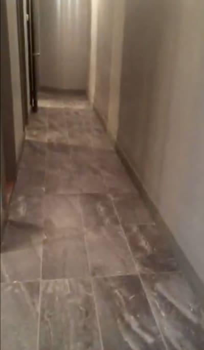 Video Stillshot of facing end of hallway