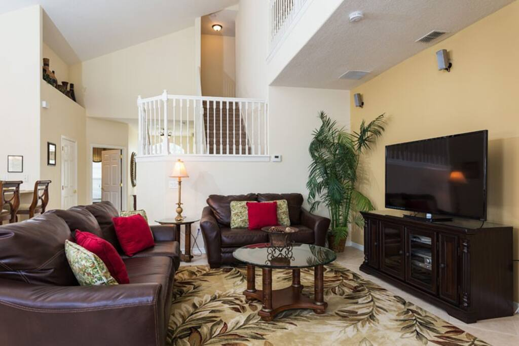 """Living Area with 60"""" LED TV, DVD/VCR Combo & CD Shelf Stereo System"""
