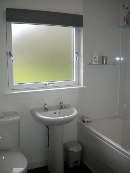 The bathroom with shower and glass screen