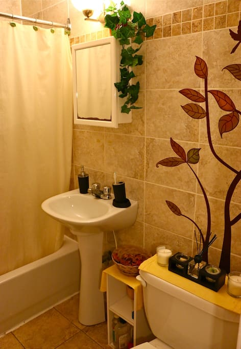 Clean bathroom with shower and bathtub, (clean sheets and towels available)