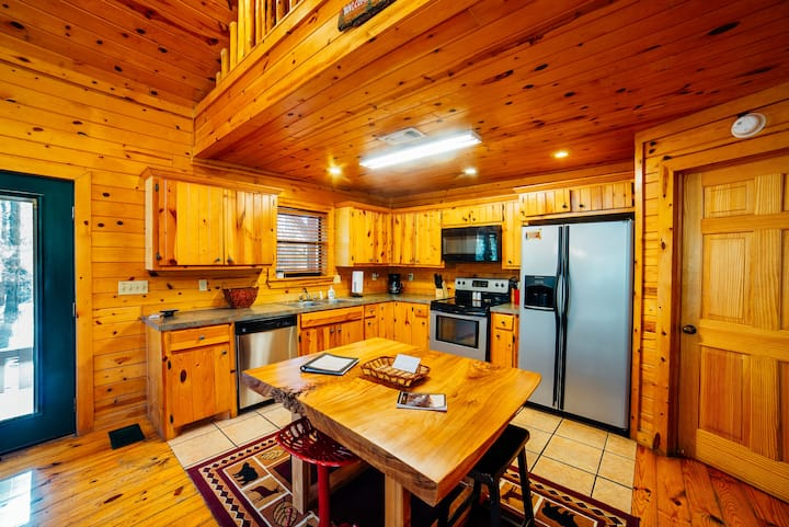 Located in the prestigious Southern Hills Addition, Wildwood cabin is sure to be a vacation destination for many years to come.