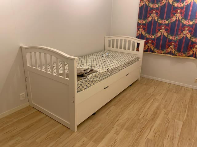 Private Bedroom with single bed and IKEA cabinet