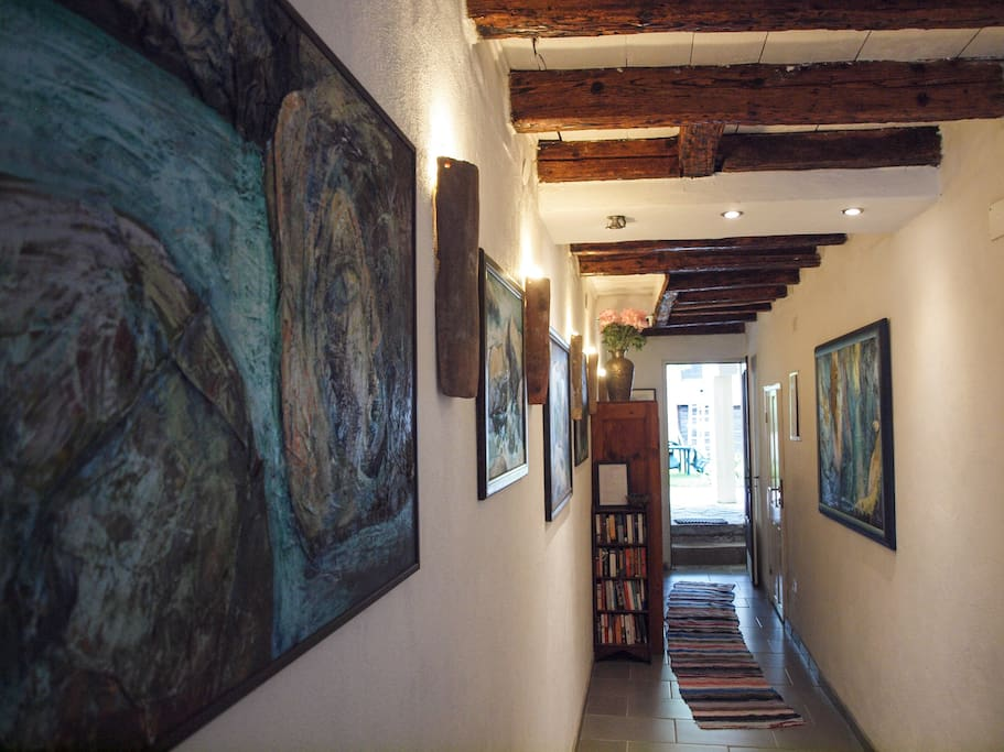The entrance hallway filled with Jana's Dolenc's paintings of the Soca Valley
