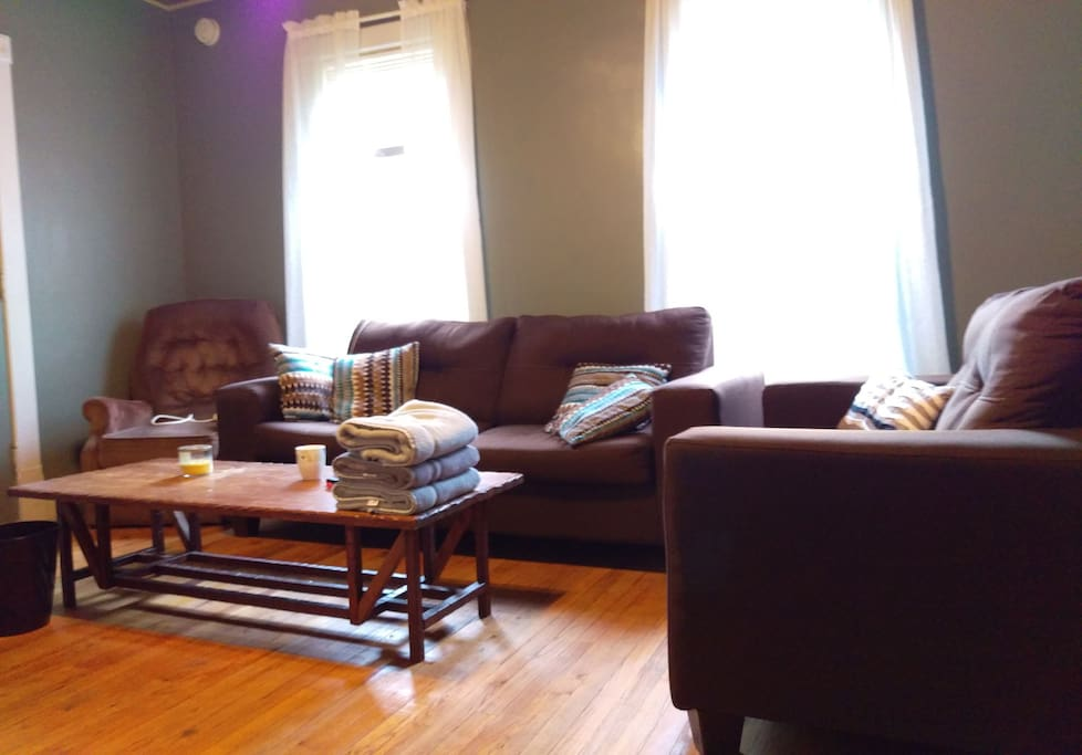 Living room with couch, love seat and recliner