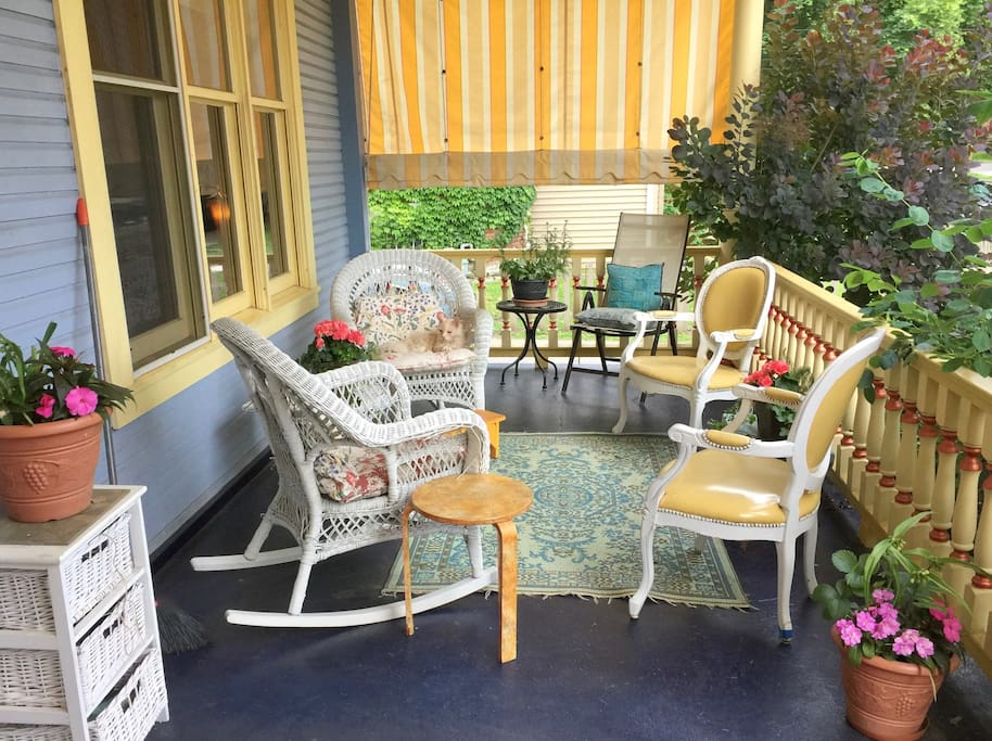 The charming front porch is your extra 3-season living room.