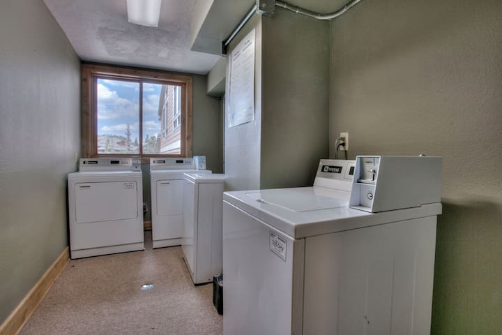 Across the hall, coin operated washer dryer.