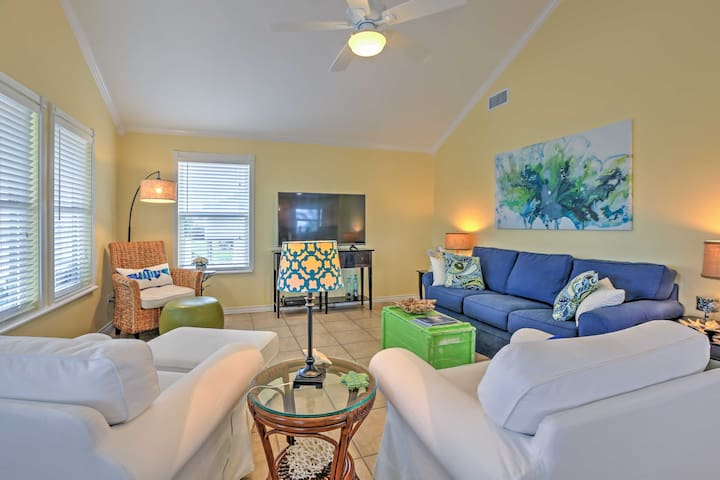 The living area includes plush furnishings and a large flat-screen cable TV.