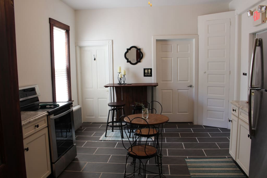 Kitchen featuring original built in cabinet to the right
