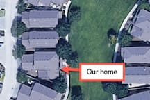 Our home faces a green belt with parking on either side of the belt.