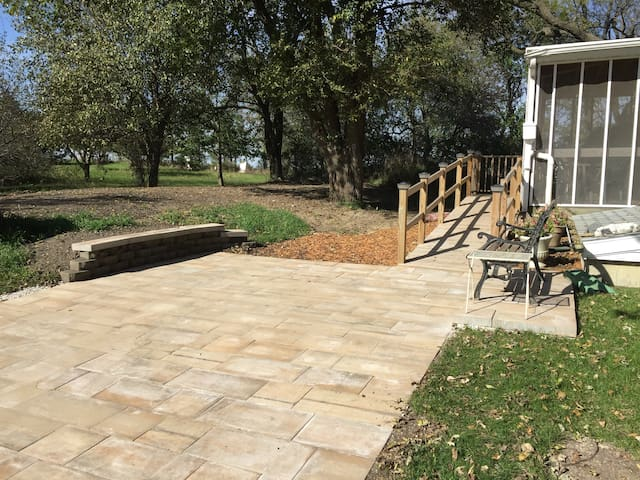 Paver parking and ramp that leads to your private screened in porch.